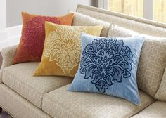 """Featuring a single floral medallion embroidered on crushed cotton velvet, the Gala pillow brings elegant cheer to sofas, chairs and beds year round. Backed in cotton/linen and finished with an organza ribbon flange. Hidden zipper. Colors: Bittersweet, Dijon or Blue.  22"""" x 22"""""""
