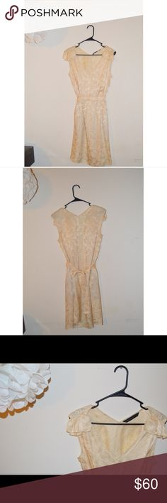 Marc by Marc Jacobs Dress Cream colored Marc by Marc Jacobs dress. Size M. 100% silk. Has light patterns on it and is semi sheer so you would need to wear a slip. Ties in the back to adjust. No blemishes, no damage. Perfect for summer or spring! Marc by Marc Jacobs Dresses Midi
