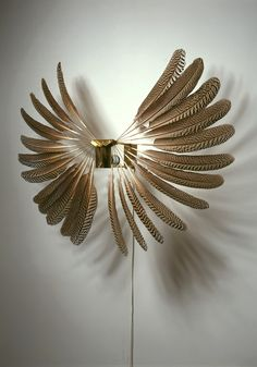 LIGHT OBJECT by REBECCA HORN -LIGHTBOX AMSTERDAM-  Looking for feathers? www.enkelsfeathers.com