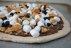 S'mores dessert pizza on the grill    makes my mouth water looking at it!!!
