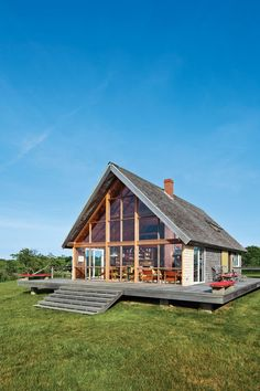 Mid-century designer Jens Risom's a-framed prefab summer retreat, located on the northern portion of Block Island, Rhode Island features an entire wall of windows that offers stunning views of the island. Photo by Floto + Warner. This originally appeared in Jens Risom's Block Island Family Retreat.
