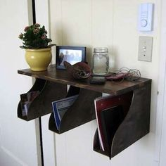 Mail Organizer If you don't have room for a complete entryway, the Knuff magazine holders can form the base of a nice landing pad to collect keys and mail. Vertically aligned under a shelf, they both support and organize your by the door catch-all.
