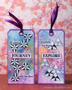 Two colourful tags, made with Visible Image stamps and Distress Oxide inks.