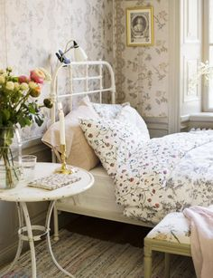 iron bed floral bedroom
