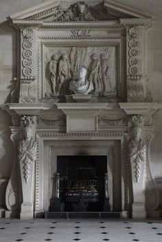 A close up of the stunning marble mantel with En Trumeau at Houghton Hall.