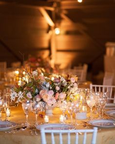 Simple votive candles and a flower arrangement for each centerpiece, allows guests to talk across the table