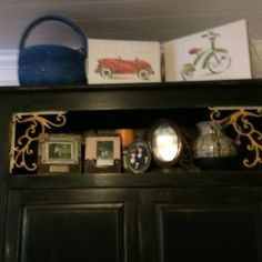 Cabinet distressed with black paint