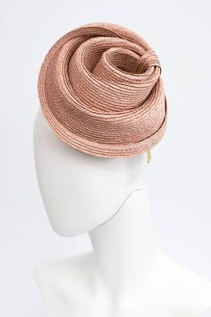 An unusual straw braid sculptural fascinator hat, shown here with a complimentary primrose yellow silk Alice band. The hat is hand formed into this unique shape which is the attached to a custom silk headband. The details: • Made to order. • One size. • Attaches with a regal silk