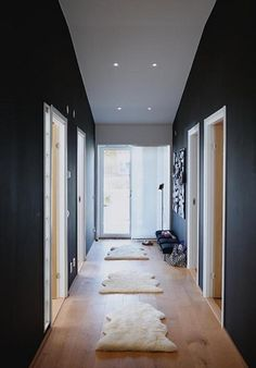 love the dark walls, wooden floors and rugs