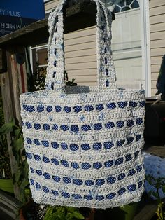 Super cute tote bag, crocheted with white/blue plarn and laced with blue polka dot ribbon.