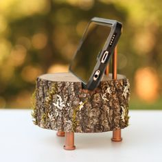 A phone charging dock that'll actually look cool on any bedside table. A phone charging dock that'll actually look cool on any bedside table. etsy.com Customize the metal colors from a selection of copper, gold, industrial grey, or rubbed bronze. Get it from Woodland Fever on Etsy for $29.95.