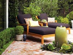 Two lounge chairs and a fountain make this patio a great place to hang out with friends or take a nap. The lounge chairs are upholstered with chocolate brown fabric, which can stand up to outdoor conditions and easily hide stains. Accent pillows add a pop of color. (Photo: Thomas J. Story)
