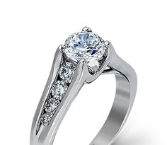 ZR409- 14K white gold engagement ring with .54ctw graduated channel set diamonds.