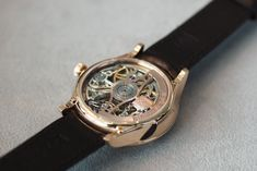 Today, Schauffhausen-based watchmaker, H. Moser & Cie, introduced a skeletonized tourbillon. The Venturer Tourbillon Skeleton comes is 41.5 mm in diameter by 14.3 mm in thick case and is crafted in red gold. An argenté-finished flange frames the skeletonized movement that is fully visible from the dial side. Red gold applied indexes indicate the hours. Leaf-shaped rose gold hands indicate the hours and minutes, with a leaf-shaped blued steel central second time zone hand. Located prom...