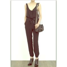 Rag & Bone Hudson Silk Jumpsuit Showcase a key runway trend in this distressed silk Hudson jumpsuit by rag & bone. Create a sleek silhouette out of supple silk by cinching in at the waist and teaming with towering heels. Seen here with Alexander Wang Brenda small leather shoulder bag and Caroline sling back high-heeled ankle boots. Fits true to size. Model is 5'9. Great condition! No tear, stain or holes. rag & bone Dresses