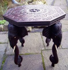 "The 4 elephant legs are beautifully carved,even the back of the heads are carved.Each leg weighs 2.2kg. The table is 62.5cm/24.5"" tall. Nice colour and patina. Full sets of tusks,eyes and ears. 