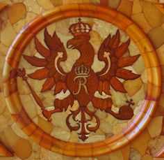 Detail of mosaic from the opulent Amber Room, part of an 18th century Russian castle.  The castle was destroyed during World War II.  This is one of a few recently-uncovered artifacts that survived.