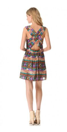 WOODSTOCK DRESS $66.42 SPECIAL $35.20 YOU SAVE: 47% A Southwest-inspired print looks cheerful on this casual gauze dress. A lattice of wide straps cross the open back, and a wide panel of covered elastic defines the waist. Lined.