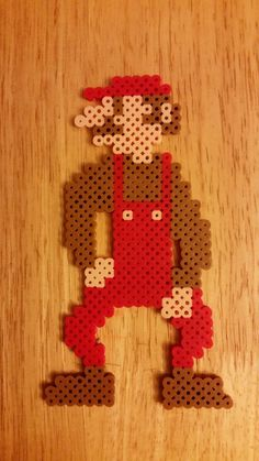 Skinny Mario Perler by jrfromdallas on DeviantArt Hama Beads Mario, Pearler Beads, Mario Coloring Pages, Super Mario Art, Anime Pixel Art, Bead Art, Beading Patterns, Diy And Crafts, Cross Stitch