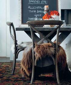 fur-blanket-bentwood-chairs-table-scandinavian-decor-white-walls-eclectic-room