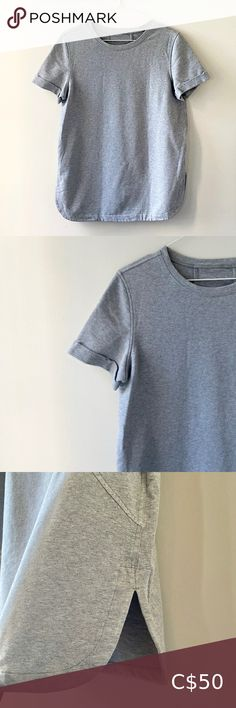 """Lululemon sweater tee Lululemon Sweater tee - Super comfortable for an on-the-go outfit. It's similar to a sweatsuit material, different from lululemon's other fabrics they use on their shirts. This has a more structured look and feel, as can be seen when it's hanging.   Colour: light grey ; closely resembles first picture.  EUC, 10/10. No snags or piling. Looks new.   Size 4- can fit size 6 ( I wear size 6 lululemon bra).  Measurements when layed flat:  Armpit to armpit : 19""""  Length from… Colour Light, Plus Fashion, Fashion Tips, Fashion Trends, Lululemon Athletica, Tees, Shirts, Fabrics, T Shirts"""