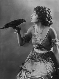 Mary Pickford holding her parrot