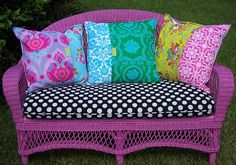 pink wicker bench with amazing colorful pillows
