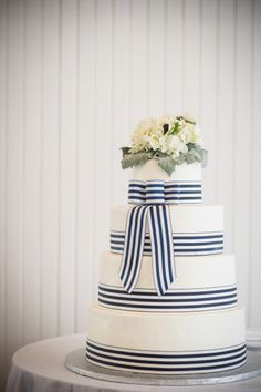 Navy and white striped wedding cake: http://www.stylemepretty.com/massachusetts-weddings/harwich-port/2014/06/20/coastal-cape-cod-wedding-at-wychmere-beach-club/ | Photography: Zev Fisher - http://zevfisher.com/