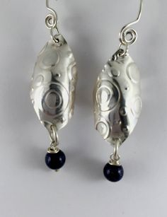 Argentium sterling silver with blue gold stones. Earrings measure approximately 1 3/4 inches from ear.