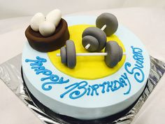 Cake With Blue Icing Fondant Eggs And Dumbbells Fitness Freaks Are Allowed To Have One Cheat Day Get Birthday Cakes Delivery In Mumbai A Exotic