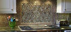 beautiful silver and gold kitchen backsplash