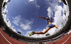 London 2012 Olympics: Photographers' tricks (see slide show and Olympic picture galleries), at The Telegraph — this photo: Ukraine's Hanna Demydova makes an attempt in the women's Triple Jump qualification during the athletics in the Olympic Stadium at the 2012 Summer Olympics