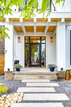 front doors with glass balcony black cedar soffits entry pathway modern farmhouse porch swing wall sconces white siding of Fascinating Front Doors with Glass to Maximize the Beauty of Your House