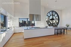 wood floor, white cabinets, grey counter