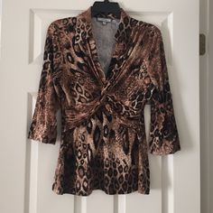"Laura Max Animal Print Stretch Top Laura Max Animal Print double wrap 3/4th sleeves stretch top. Size M. Measurements:  16"" Chest, 13"" unstreched Waist, 24"" Length and 11"" Sleeve Length. 93% Rayon and 7% Spandex. Gently used and good condition. No trade, no holding, no off sight payment Laura Max Tops Blouses"