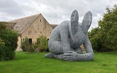 Sophie Ryder's signature 'Lady-Hare' crouches in front of the home that she and her ex-husband built themselves