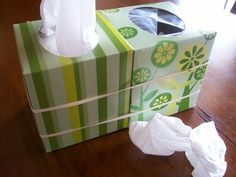 Tissue box and garbage can all in one. Can be used on tables to prevent kids from having to get up and throw tissues away.