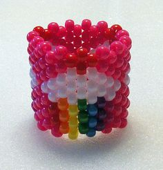 Kandi Rainbow Cupcakes Cuff Bracelet Fits 6 Wrist Stretchy Perfect for raves, festivals, gift, trade PLUR Beaded Bracelet Patterns, Beaded Jewelry, Beaded Bracelets, Bead Crafts, Arts And Crafts, Hot Pink Background, Kandi Cuff, Kandi Patterns, Rainbow Cupcakes