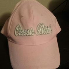 """Classic Bitch"" ball cap Light pink ball cap, never worn. Has words ""classic bitch"" in white outlined with silver glitter. Velcro in back Accessories Hats"