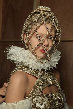 F/W'13 Alexander McQueen Haute Couture. Pin curls under head cages