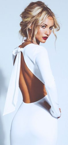 Backless white dress - love the hair, makeup and outfit