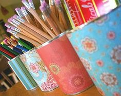 Decoupage repurposed cans - great for holding writing or drawing implements #DIY #recycled