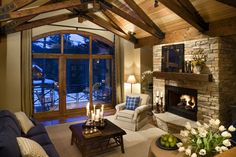 Mountain or lake house living room--- love the view and the warmth of the room. Dream on . . .