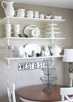 love the open shelving... I SO WANT to do this when we redo our kitchen??