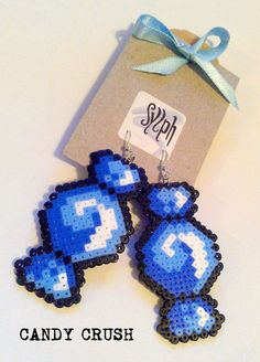 Purple geeky pixelated Candy Crush earrings made of Hama Mini Perler Beads Perler Earrings, Diy Perler Beads, Perler Bead Art, Pearler Bead Patterns, Perler Patterns, Loom Beading, Beading Patterns, Hama Beads Design, Do It Yourself Jewelry