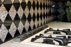 Diamond-patterned backsplash behind stove in kitchen