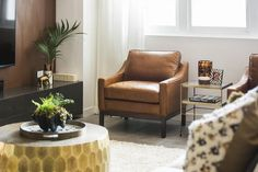 Shop gorgeous living room style including the caramel leather chair tortoise shell candle and coffee table at The Block Shop now. Just search 'See the Rooms' for details Shell Candles, Interior Styling, Interior Design, Beautiful Space, Building A House, Family Room, Armchair, Sweet Home, Art Deco