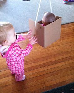 LOVE this idea!!  pretend swing for a doll.  great standing balance therapy