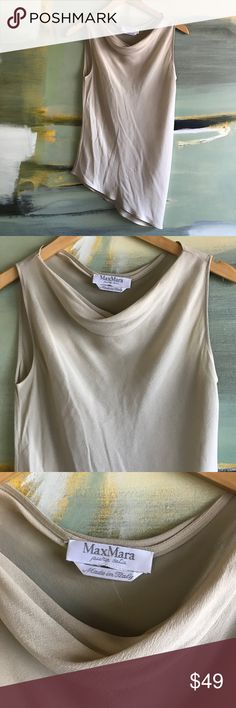 Max Mara asymmetrical top Max Mara made In Italy. This chic asymmetrical double layer sheer Top is chic and a classic piece for styling. Layer under your suit for a sophisticated look or wear with jeans and booties to brunch . However you style this one you will without a doubt look trendy and timeless. Max Mara Tops
