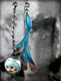 Ebb earrings. Ceramic barnacle and filigree seaweed kelp. A pair of mismatched earrings from nova of sweden